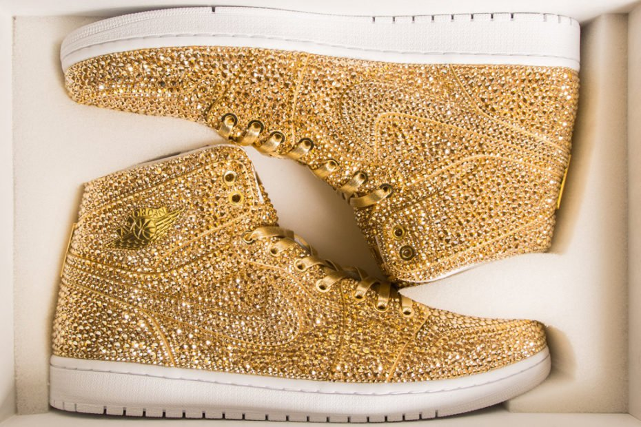 """0efe6939b83 ... Jacob s crystal-covered made-to-order Nike Air Jordan 1 is a decorative  sculpture. He calls it these limited-edition Air Jordan 1 """"Golds"""""""